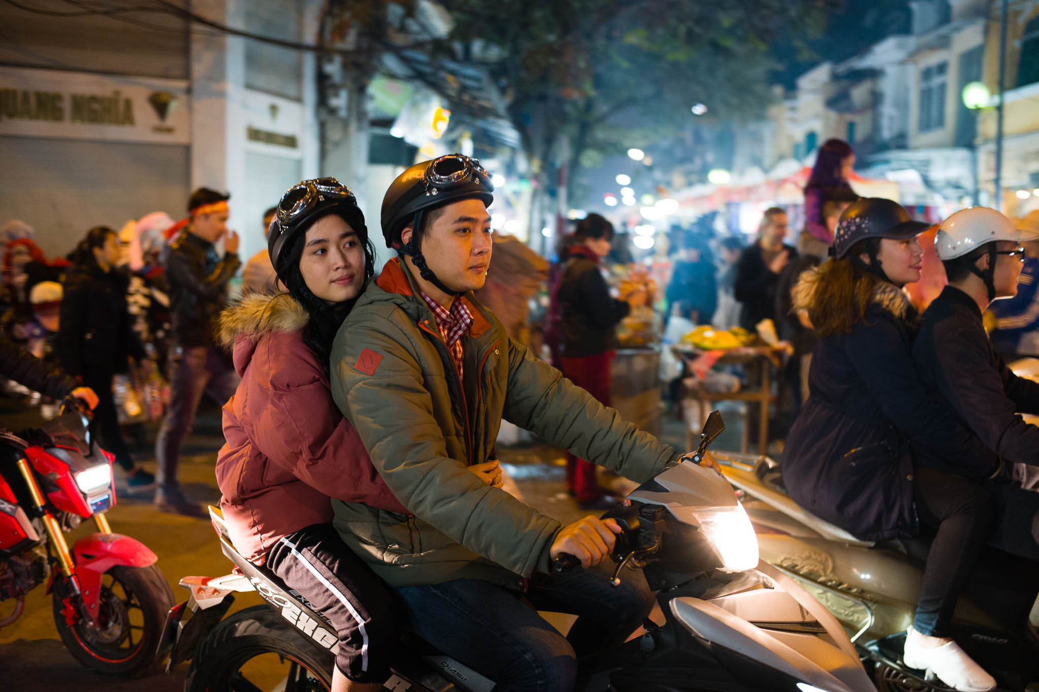 A couple rides through the streets of Hanoi – bikes are everywhere here. Leica M10-P, Summilux-M 35mm f/1.4 ASPH.