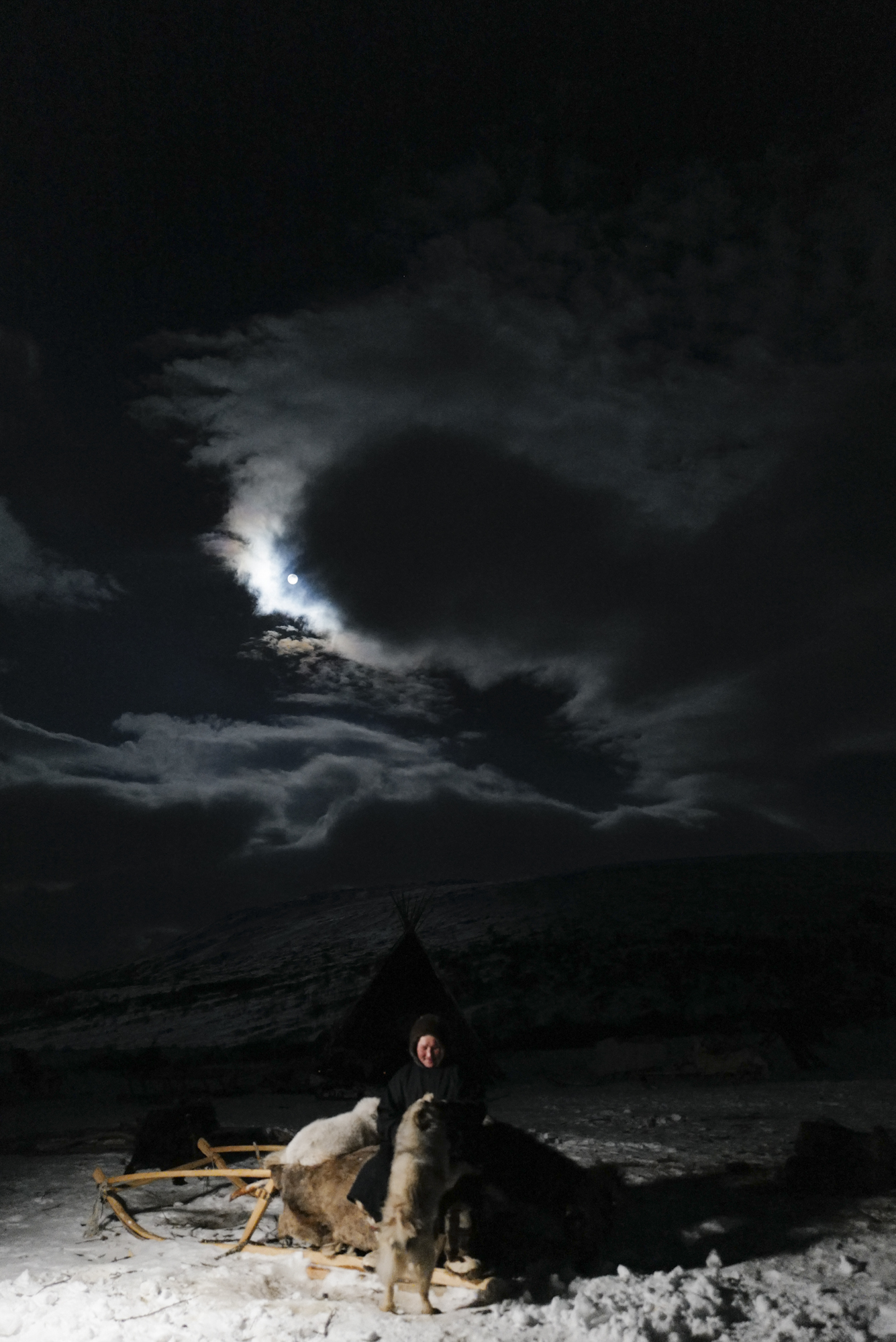Beautiful full moon night, Aleksander is playing with his dogs after dinner. Photographed with Leica Q2, Siberia, 2019.  ©  Rosalynn Tay.