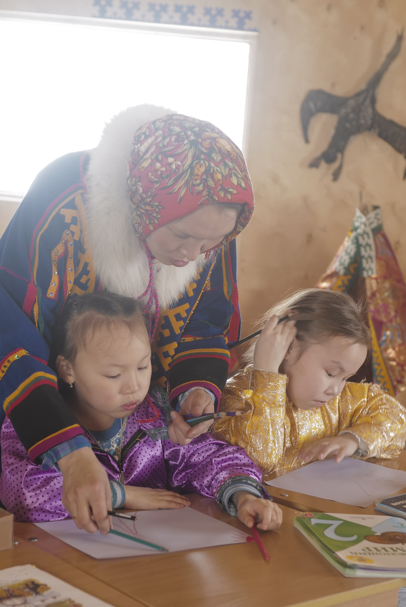 Nenets school teacher is teaching her students in the classroom. Photographed with Leica Q2, Siberia, 2019.  ©  Rosalynn Tay.