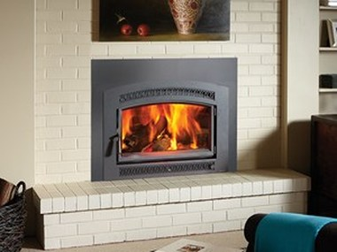 The Fireplace Xtrordinair Large Flush Wood Plus Hybrid-Fyre™ Insert Arched wood insert is available at Ferguson's Fireplace & Stove Center.