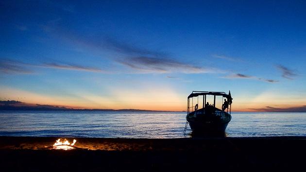 Lake Shore Lodge Tz - Lake Tanganyika - Adventure Safaris - Wanderer and beach fire.jpeg