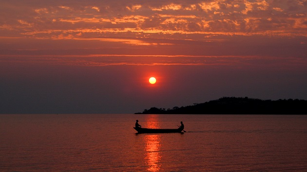 Lake Shore Lodge Tz - Lake Tanganyika - Activities - Sunset Cruise - Red sunset with local boat.JPG