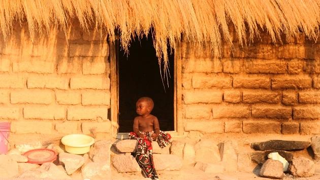 Lake Shore Lodge Tz - Lake Tanganyika - Giving back - Mvuna village - House & child.jpg