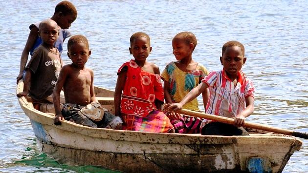 Lake Shore Lodge Tz - Lake Tanganyika - Giving back - Mvuna children in boat.jpg