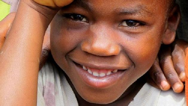 Lake Shore Lodge Tz - Lake Tanganyika - Giving back - Boy from Mvuna.jpg
