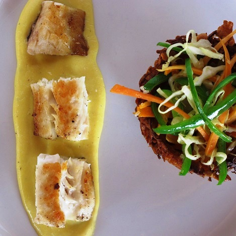 Lake Shore Tz - Lake Tanganyika - Fresh fish with stir fried vegetables in a potato basket.JPG