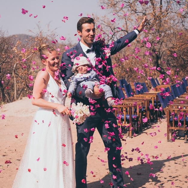 Lake Shore Lodge Tz - Lake Tanganyika - Special events - Wedding - The bride & groom showered in flowers.jpg
