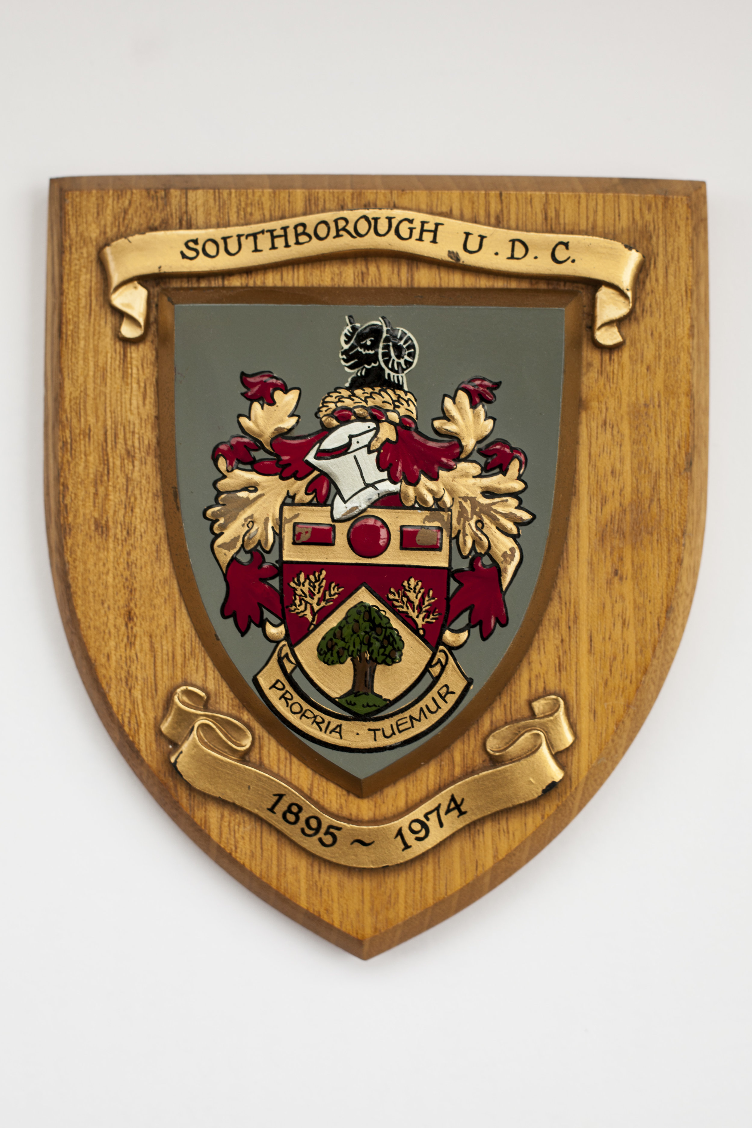 The shield with hand painted coat of arms given to all Council members and employees on the 31st of March, 1974 to mark the close of business of the Southborough Urban District Council.