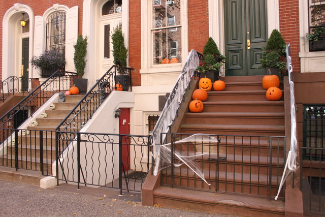 Brownstones in the Village decorated for Halloween. A welcoming sign for kids to come get some candy! -Photo by Kim Renfro, Tech Insider
