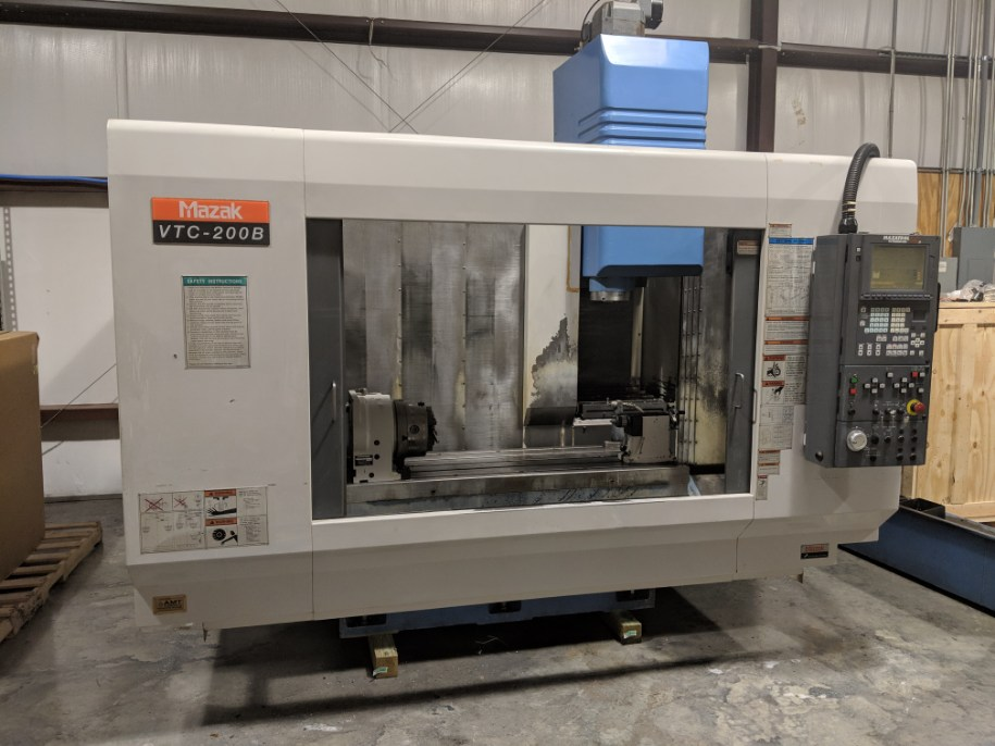 """2000 VTC-200B - Great running 2000 Mazak VTC-200B w/Mazatrol Fusion 640M Control. This machine came out of an aerospace facility in South GA. Notorious for taking care of their machines. This machine features:Synchronized Tapping / Adaptive Feedrate Control / Tool Life Monitoring / Rotary Table – 10"""" / Chip Conveyor / Tool SetterRequest a quote 2000 VTC-200B"""