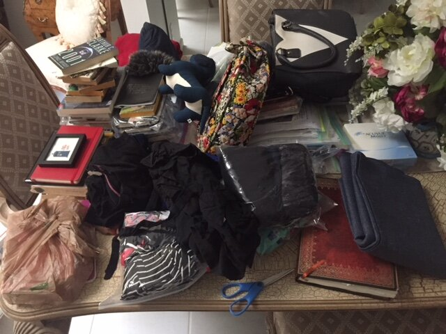 All that remained from my apartment: journals, books, purses, clothes.. The folded yoga mat I schlepped all the way from Marfa, Texas to Denver, Colorado and then flew back to New York City.