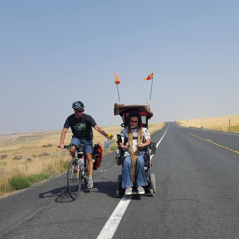 Ian Mackay is making his second cross-WA bike tour on his sip-and-puff wheelchair - Ian Mackay is on a 7 MPH bike tour across Washington State for the second time. As of press time, he and his riding partners are a day's journey beyond the Grand Coulee Dam heading west on their trip from Spokane to his home near Port Angeles.