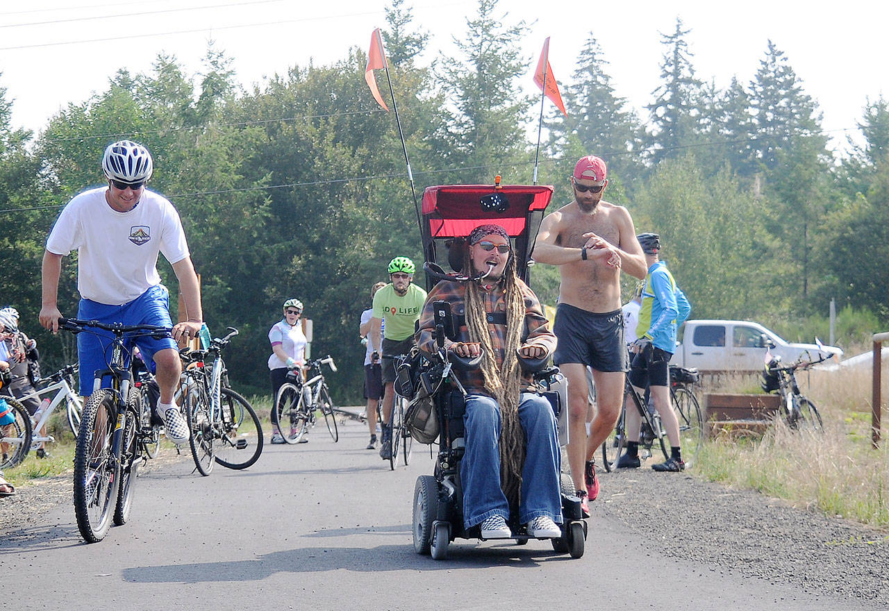 Wheels down: Agnew's Mackay completes wheelchair journey from Idaho - A triumphant Ian Mackay last week crossed the Clallam-Jefferson County line with supporters cheering him on.