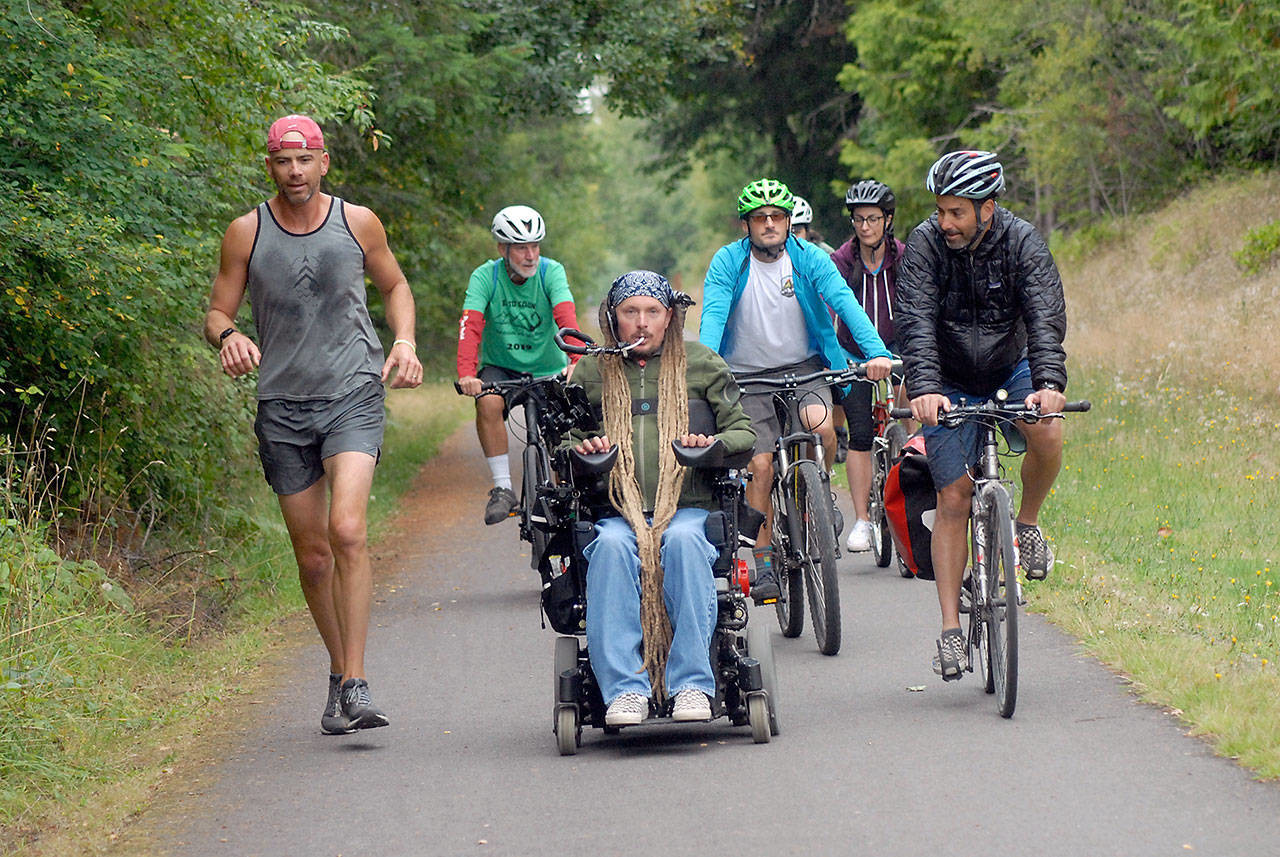"""Message of wheelchair rider in Sea to Sound journey: Get outdoors - PORT ANGELES — For Ian Mackay, seeing the world at 7 mph can be a joyous thing.To prove his point, Mackay is leading a group of friends and supporters on a three-day """"Sea to Sound"""" journey along portions of the Olympic Discovery Trail from central Clallam County to Port Townsend."""