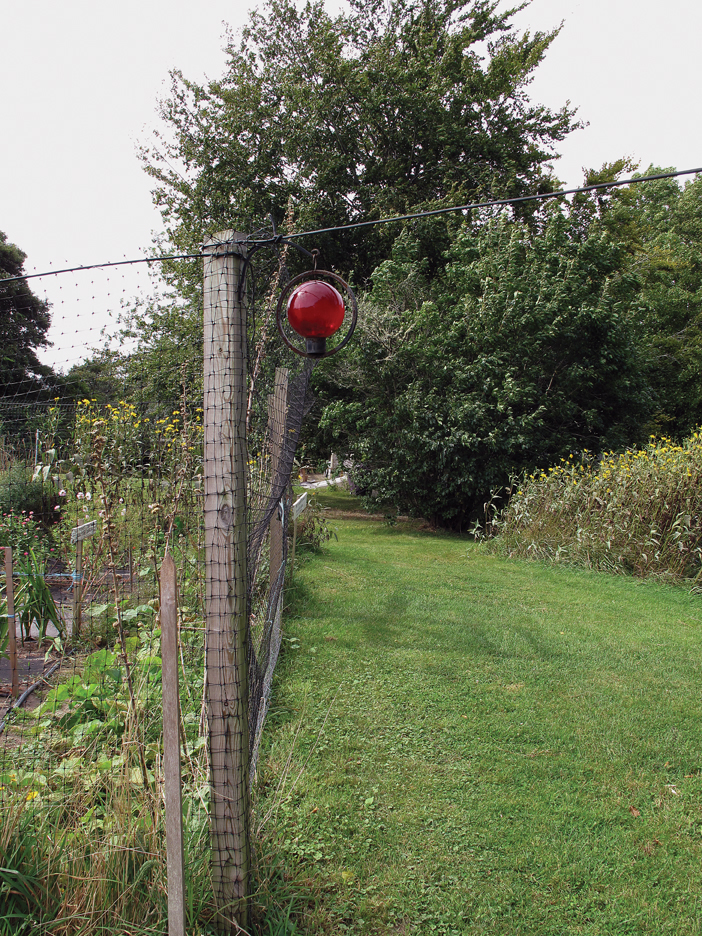 Red orb and fence post