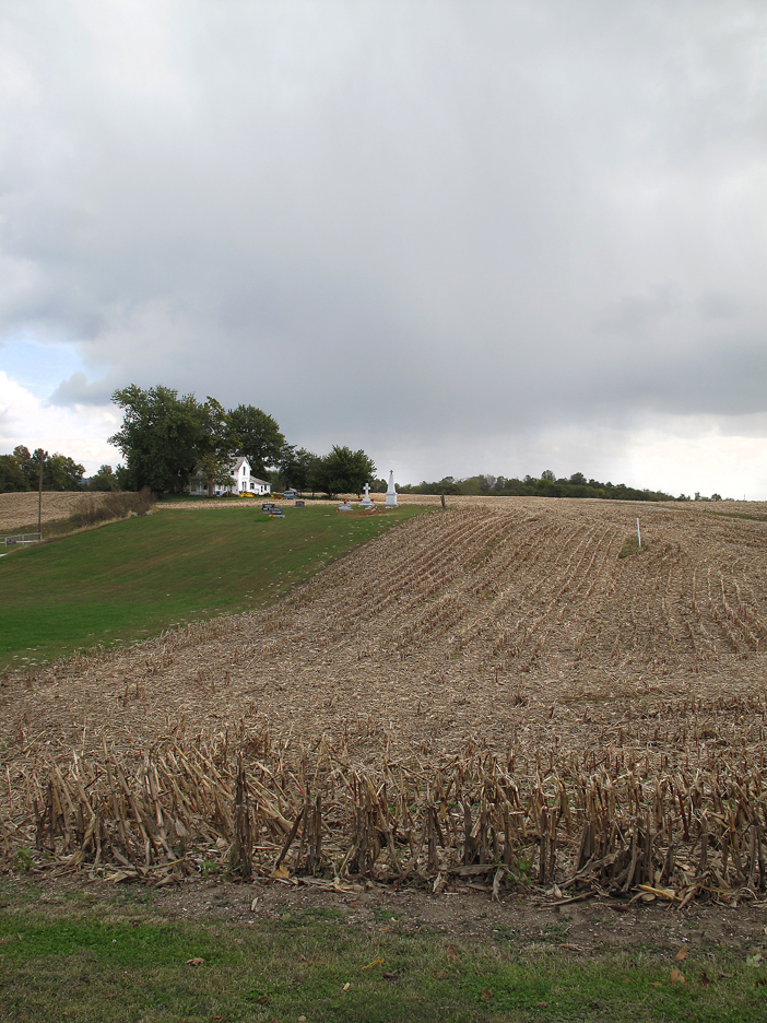 Family graveyard at harvested cornfield