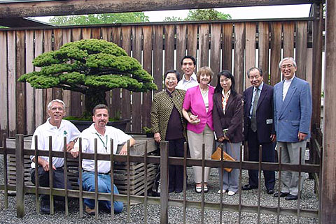 Photo left to right: curators Jim Hughes and Jack Sustic, Mrs. Takeko Yamaki Tatsuzaki, Mr. Jin Tatsuzaki, Mrs. Takehisa Iizuka, Ms. Amaki Tatsuzaki, Mr. Takehisa Iizuka, Mr. Takashi Tatsuzaki