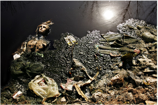 (Voss) Trash accumulates in the river in Zhengzhou.