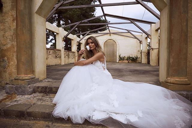 Dancing between modern ingenuity and timeless sophistication, @madilanebridal gowns tell the tale of 'girl meets dress' - a love story within itself. . . . . . #weddinginspo #bridal #confetimagazine #marbella #weddingsspain #mr #mrs #bridal #bridetobe #bridalinspiration #wedding #planyourwedding #weddingsday #destinationwedding #morningbride #weddingstyle #flowers