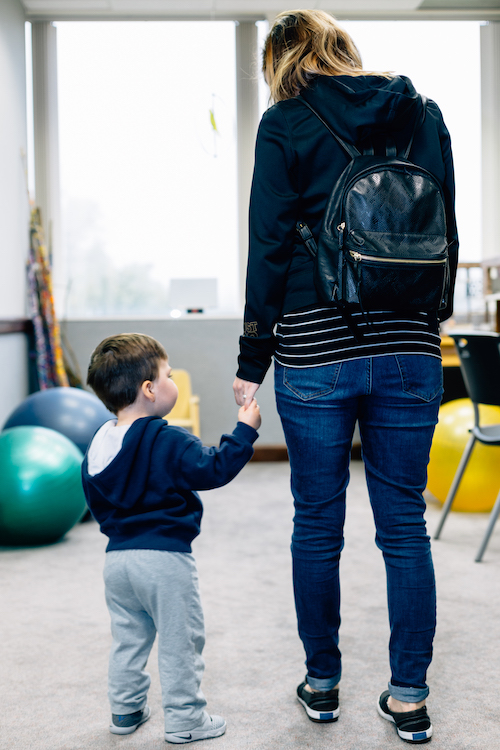 Toddler standing hand in hand with mom 2.jpg