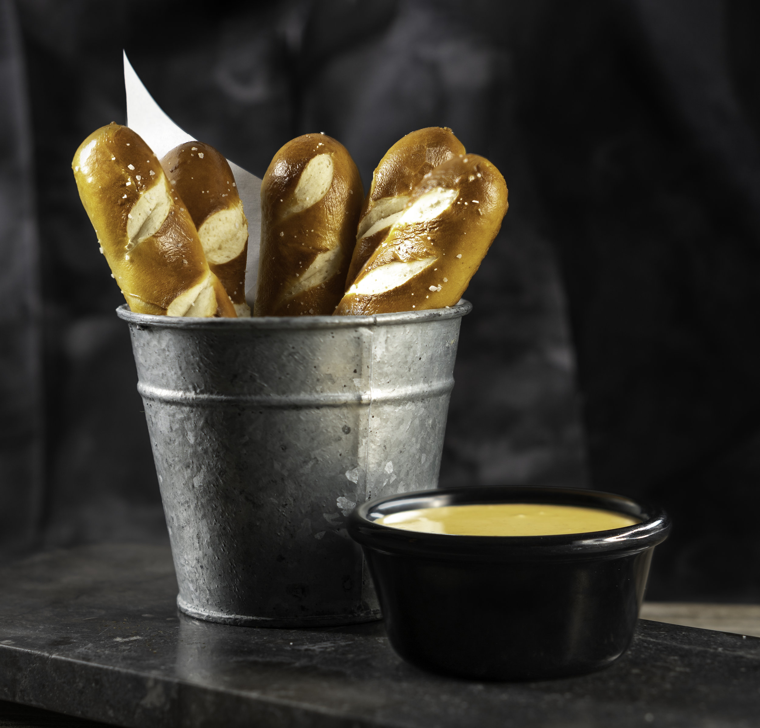 PRETZEL DIPPERS - 5 Warm salted pretzel sticks with creamy cheese dipping sauce