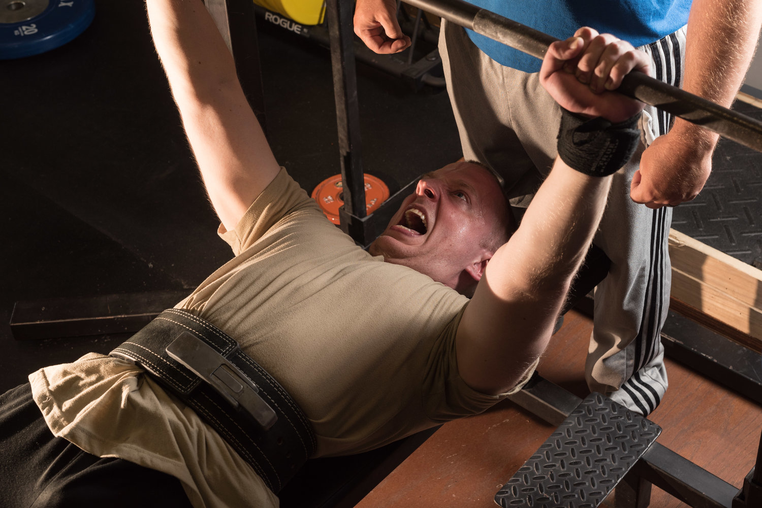 James adapted training to account for spinal fusion surgery, something many trainers would avoid. He's aggressive in terms of training, but cares about his lifters' health.