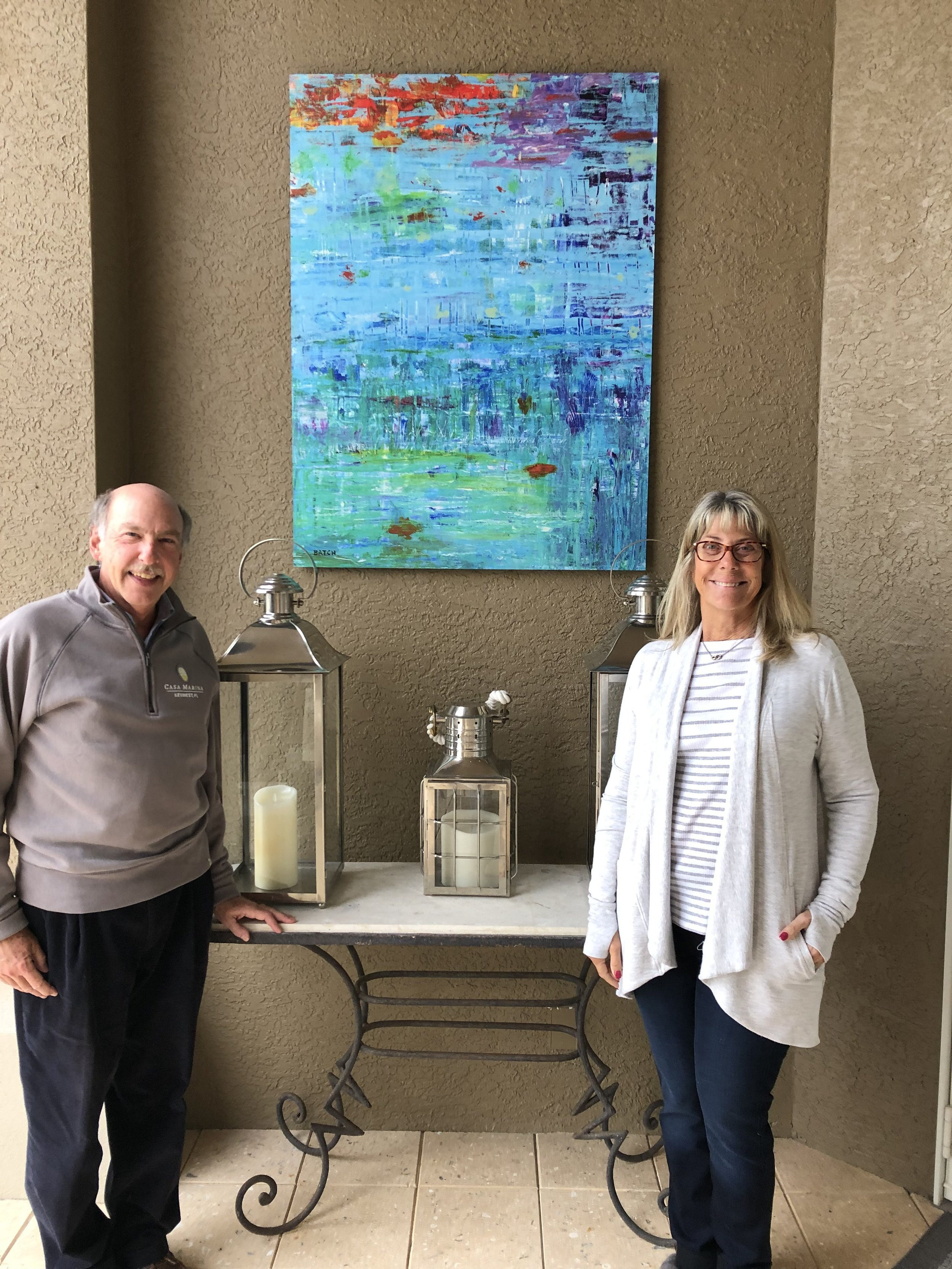 Colette and Bob Levy display the image of Natural Serenity printed on 3'x4' aluminum panel for their beautiful Floridian lanai!