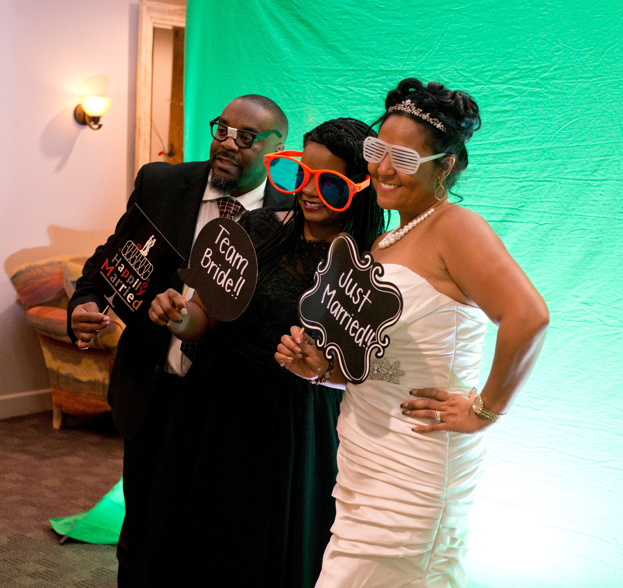 Green Screen Photo Booth - Our green screen photo booth is one-of-a-kind; with a green screen that stretches over twelve feet wide, high-quality dye sub printers, and a custom background made for each event. Including props!