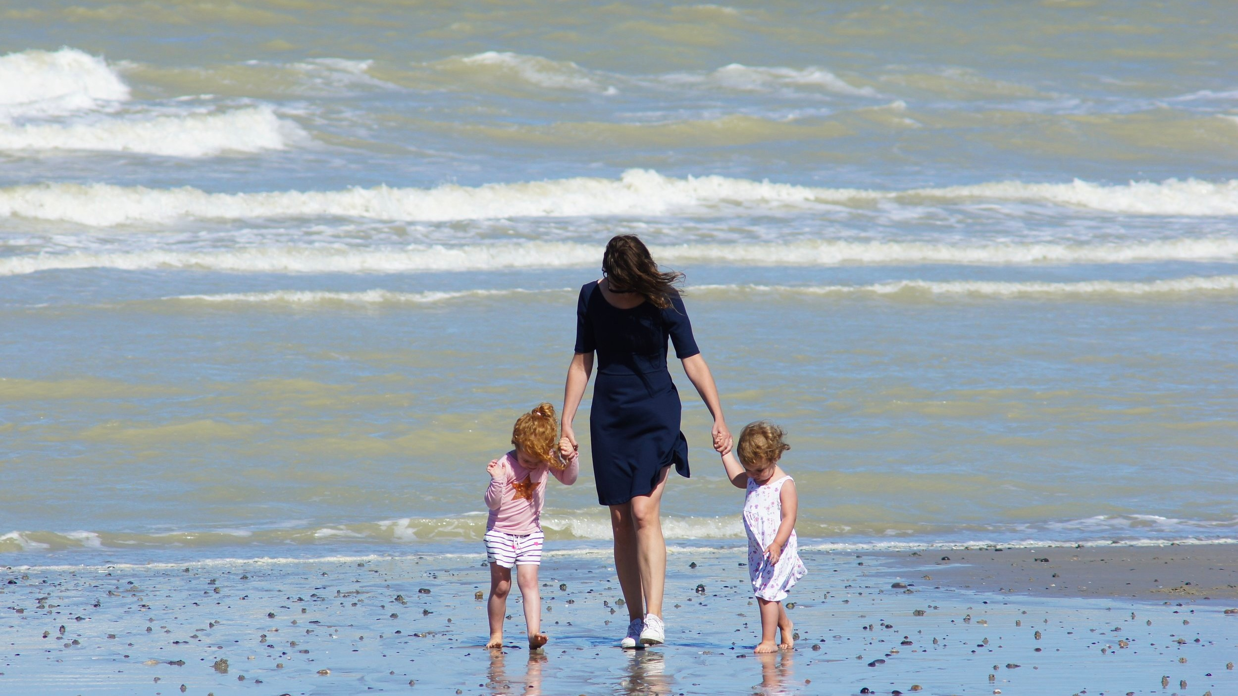 Family beach shot against the sea