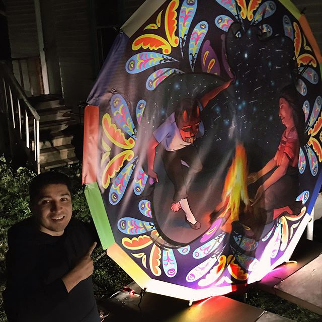 A rare smile of excitement holding up this kite I designed and illustrated for a Latinx parade. The structure was bamboo. Such a small kite by Sumpango standards but an enjoyable project nonetheless. It was a style departure from what I normally do but I might also turn the whole thing into an oil painting. #kites #sumpango #indigenous #art #mayan #fire #guatemala #ovidiocartagena #cartagenart #traditions