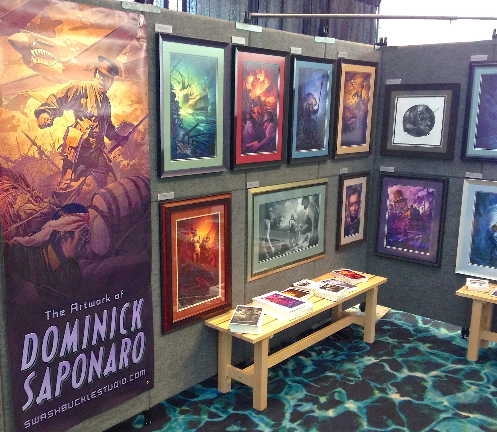 The back wall of my booth with banner and postcard take aways.