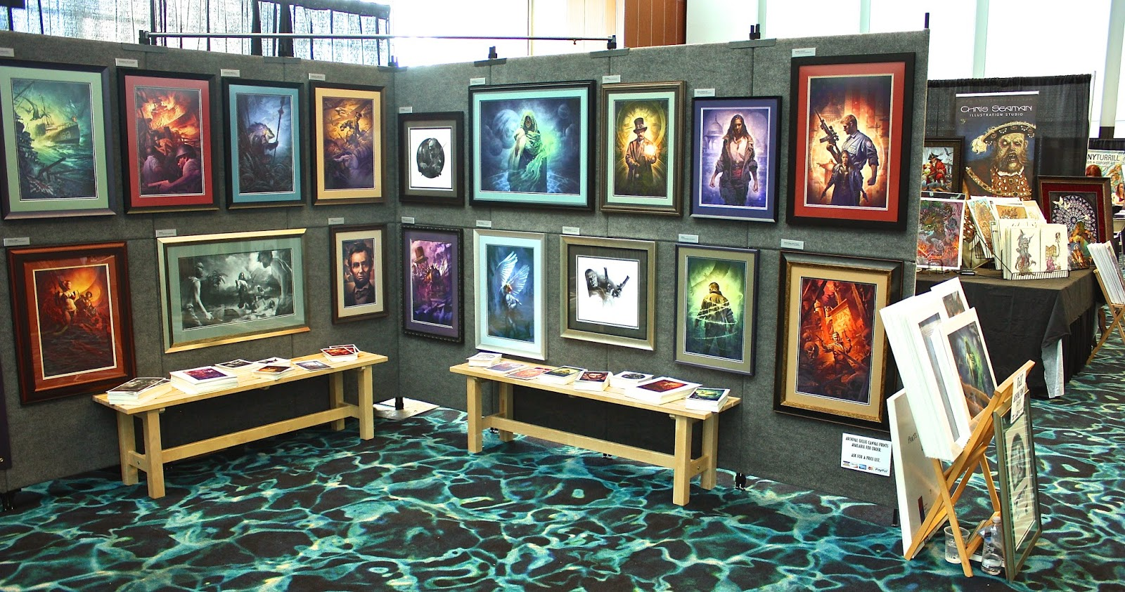 The two interior walls. Basically my portfolio framed and hung with postcard take aways and prints for sale.