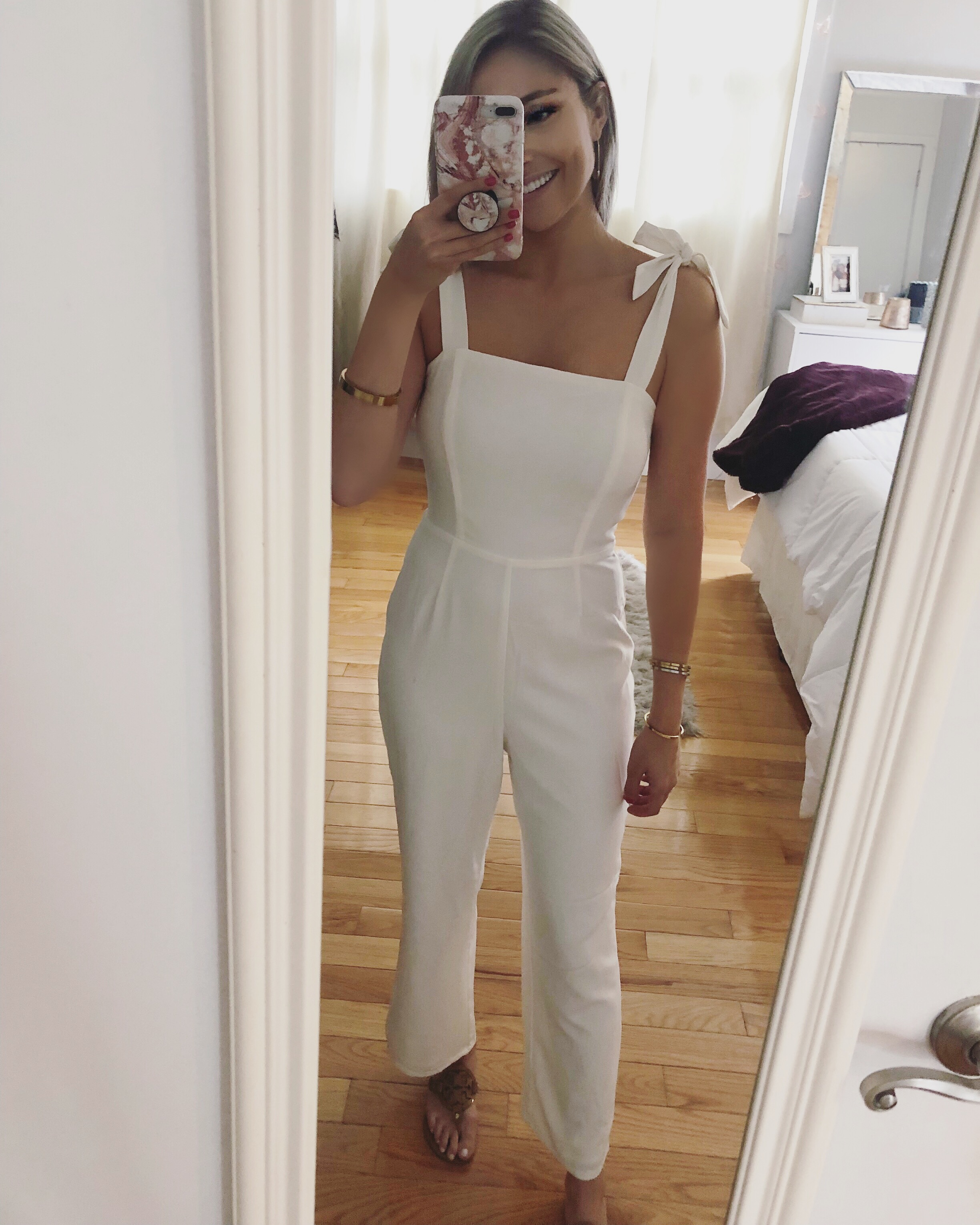 Recreate the Look: - Jumpsuit: DFTI Boutique Earrings: AnthropologieSandals: Tory Burch