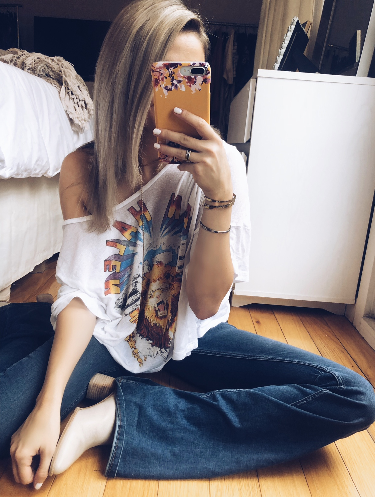 Recreate the Look - T-Shirt: Urban OutfittersBell Bottom Jeans: Free PeopleBooties: Stuart WeitzmanBracelets: MantraBand (use code 'sarahrip' for 10% off)