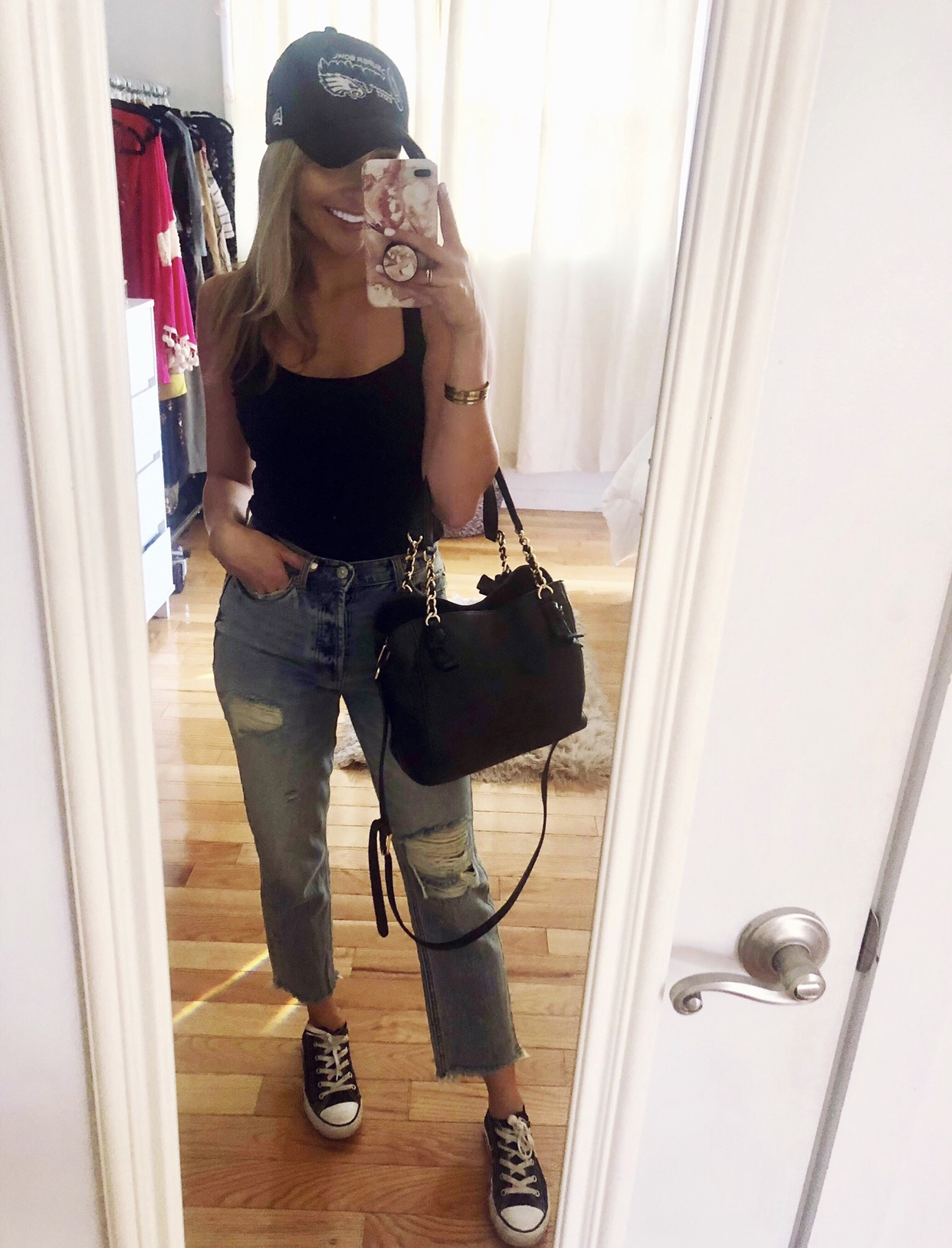 Recreate the Look: - Tank Top: Forever 21Jeans: Urban OutfittersBag: Tory BurchShoes: Converse