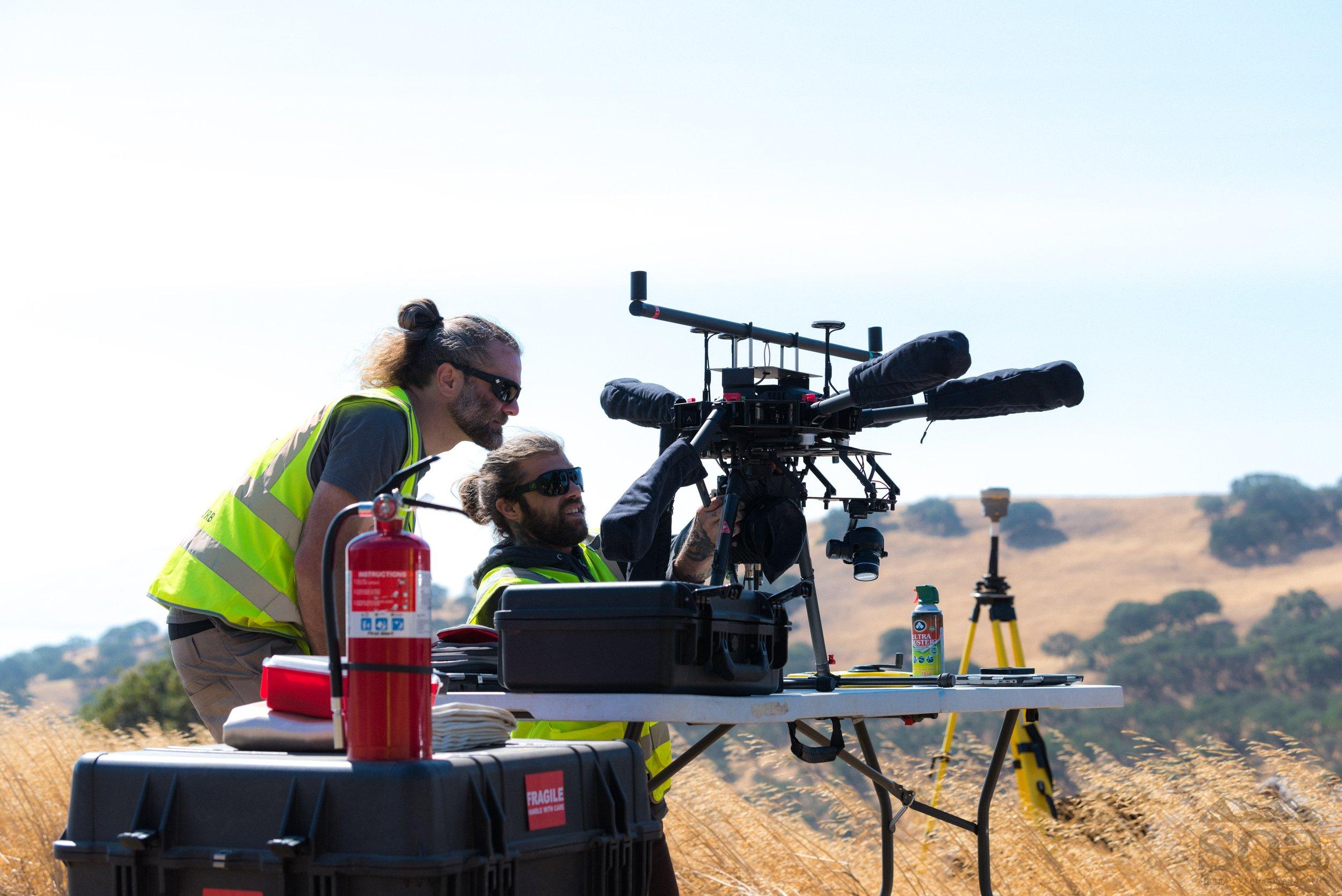 SOA field crews preparing a LiDAR-equipped sUAS for flight in Tulare, CA.