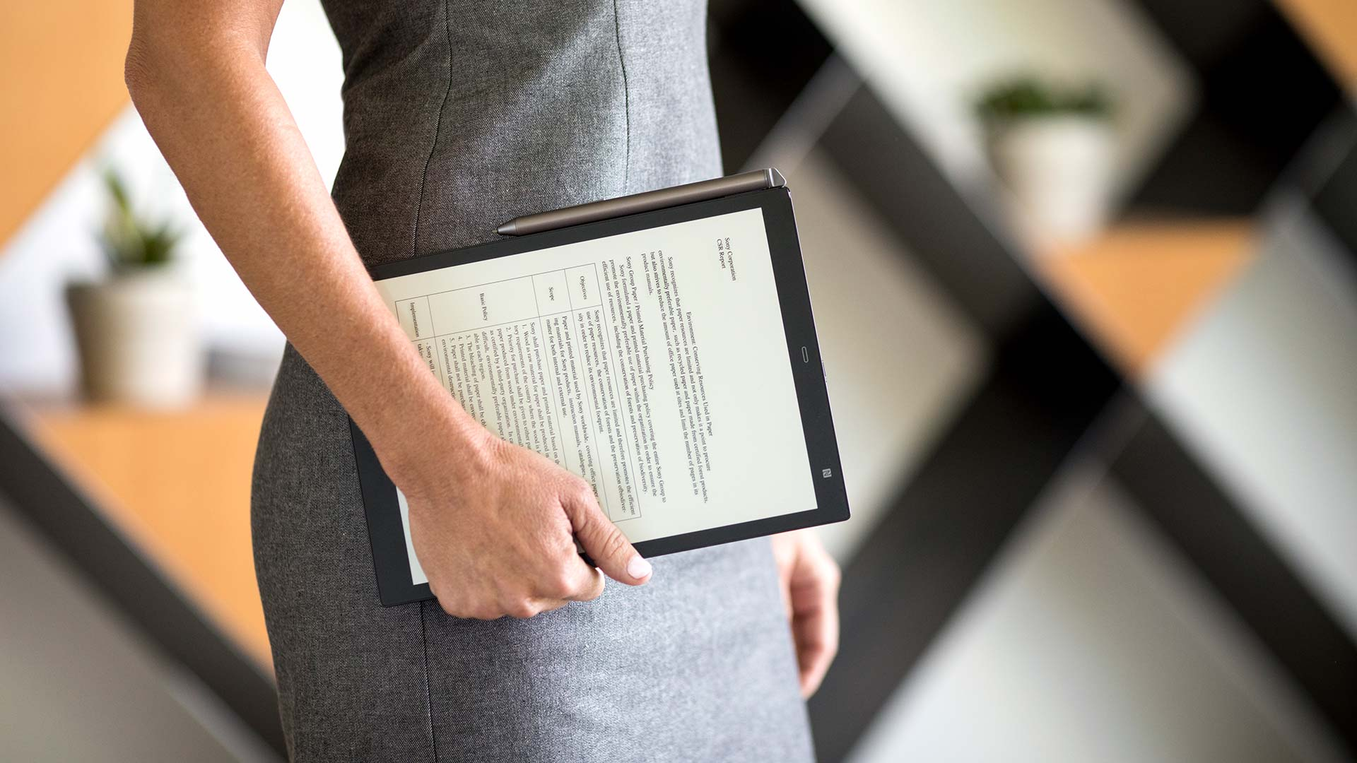 sony-digital-paper-photoshoot-woman-carrying-tablet.jpg