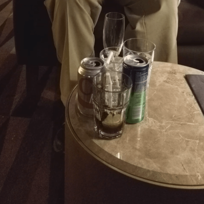 Previous Table Occupants' Trash Ignored in Lounge