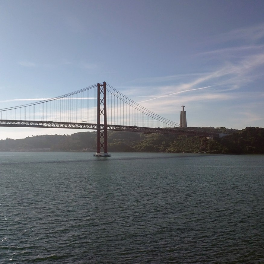 San Francisco-esque bridge and Christ facing Brazil's Christ the Redeemer