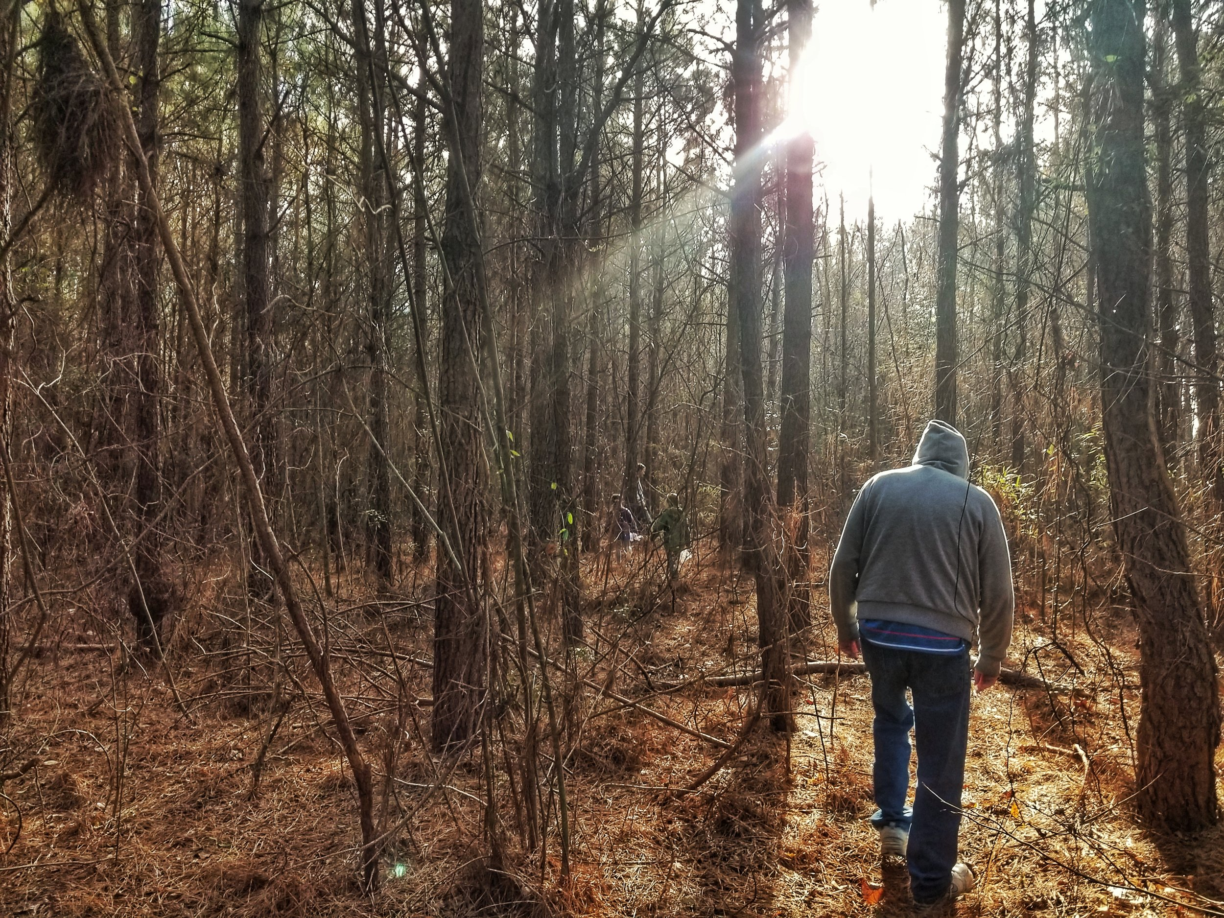 My dad and nephew walking in the woods on our farm in Eastern North Carolina