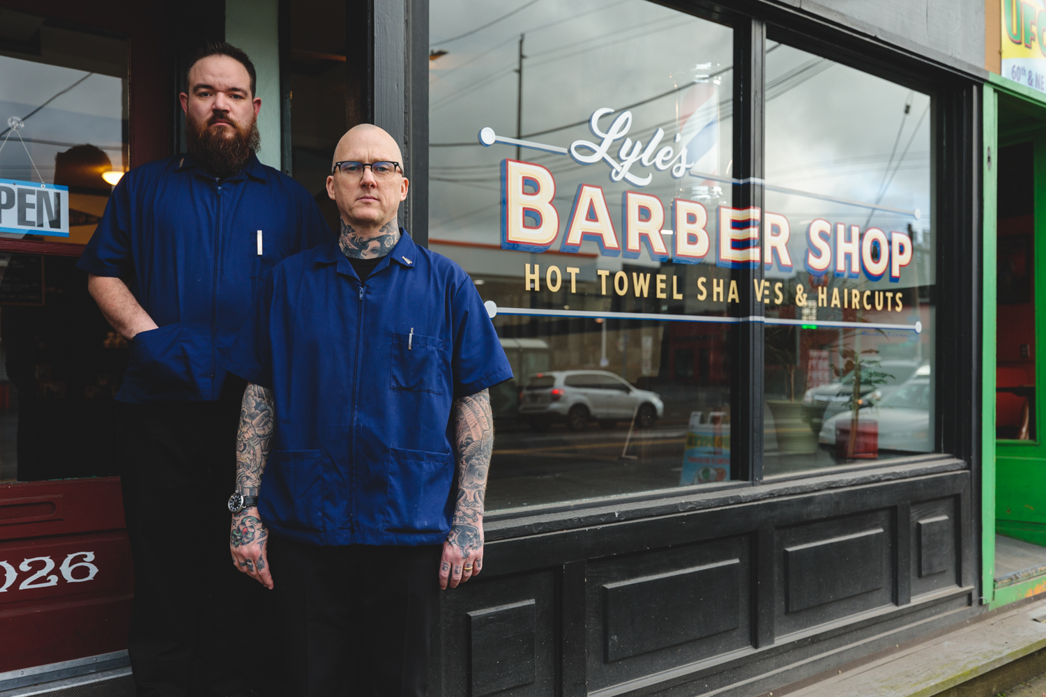 Brian Burt and Kris Perry standing outside Lyle's Barbershop.
