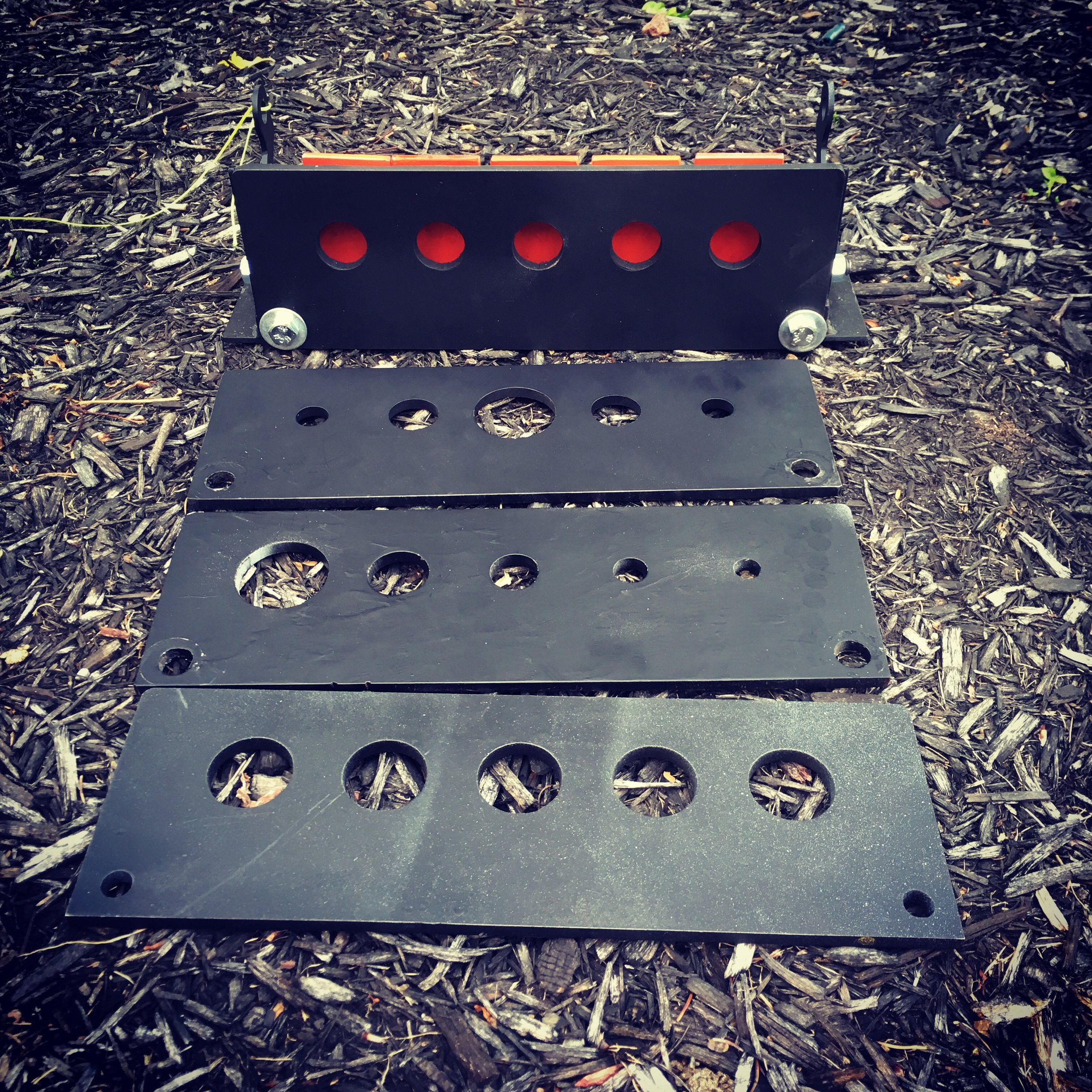The Core Product, The Modular, Portable, 3-dimensional, Rx Target . Representing American and World field target and rapid fire shooting. Currently 70 foot-pound rated target at 30 yards.  Shown here with all four configurations, demonstrating the interchangeability of the face plates.