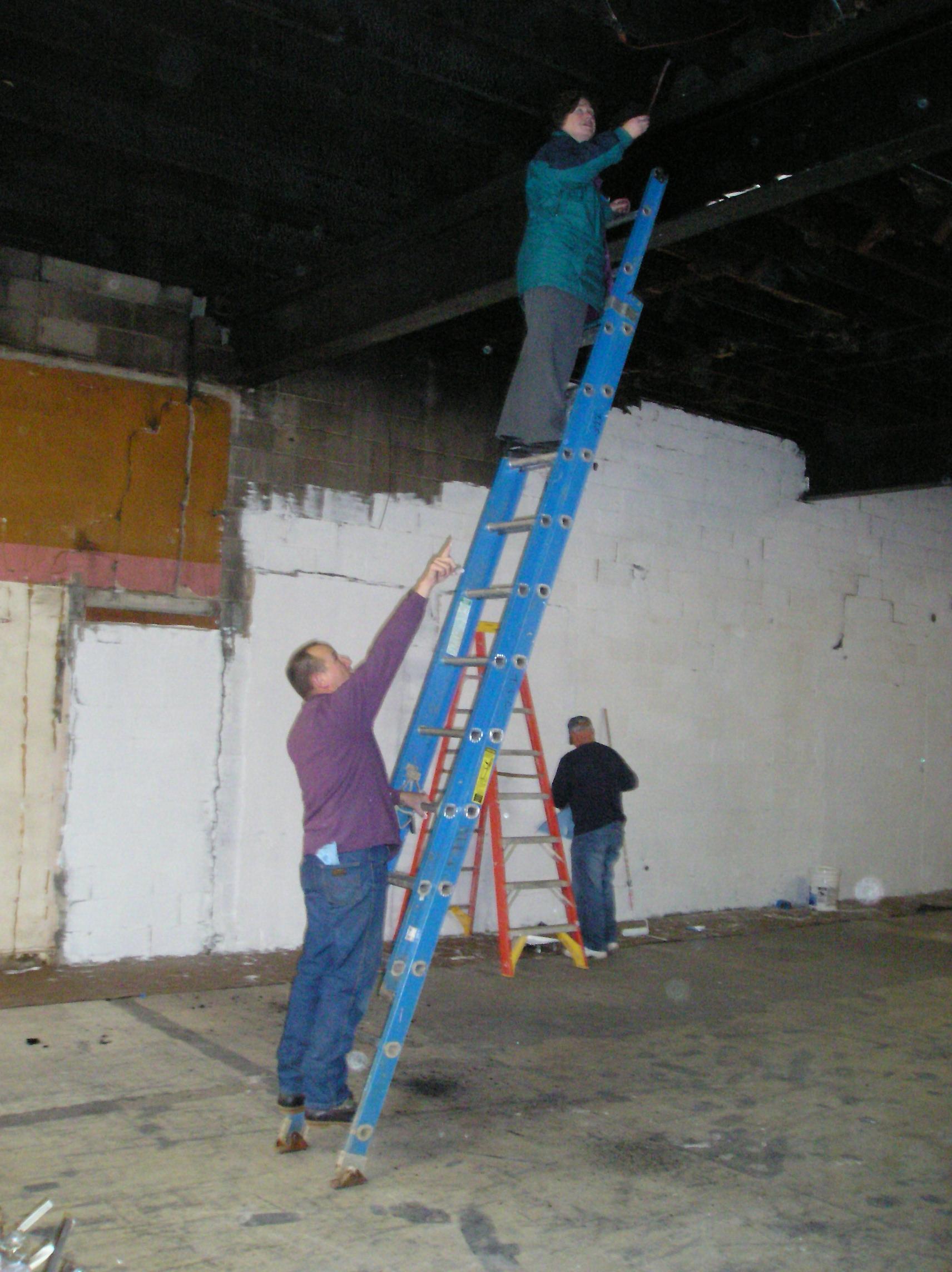 Calvary Temple Fitness Center_Engineer Cheri Leigh inspecting burnt timbers.JPG