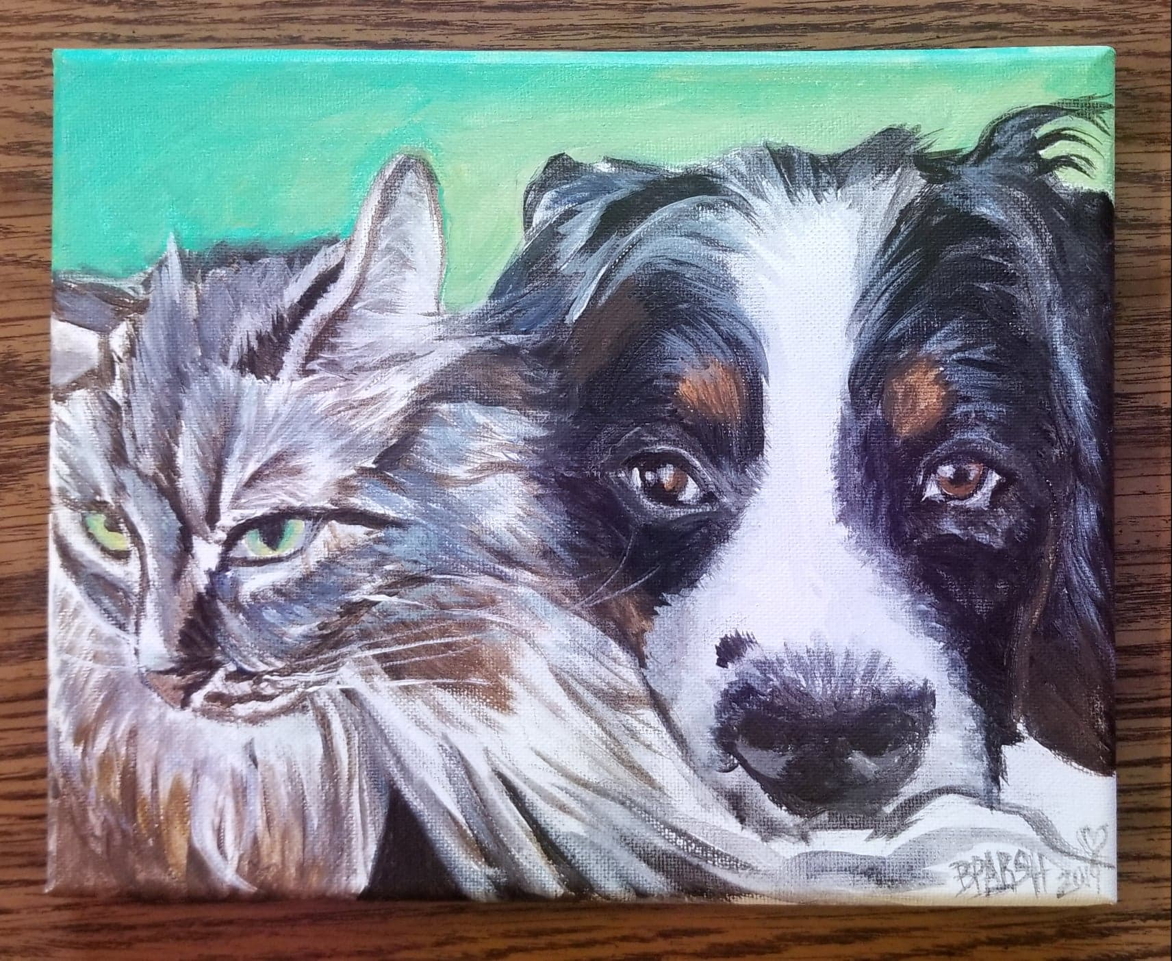 Danny the kitty cat & Reggie the bernese mountain dog (may he rest in paradise) <3 for a big 40 surprise present!