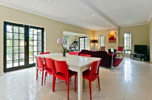 5. Chairs - Another easy way to add color to your decor is with fun colored chairs! Turn a boring dining room into a space that you are excited to entertain in! Check out this awesome dining space transformed by bright, red chairs!