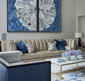 6. Artwork - A great idea for adding color to a room is through artwork. With the addition of artwork, you can showcase your style and bring color into any space! You can also add small decorations with the same colors to complete the space, as shown in this photo!
