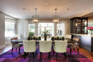 10. Rugs - If your decor is already complete, simply add a colorful rug to any room! Check out the pink and purple rug in this dining room! While the furniture and decorations may be minimalist, the rug makes the space fun and exciting!