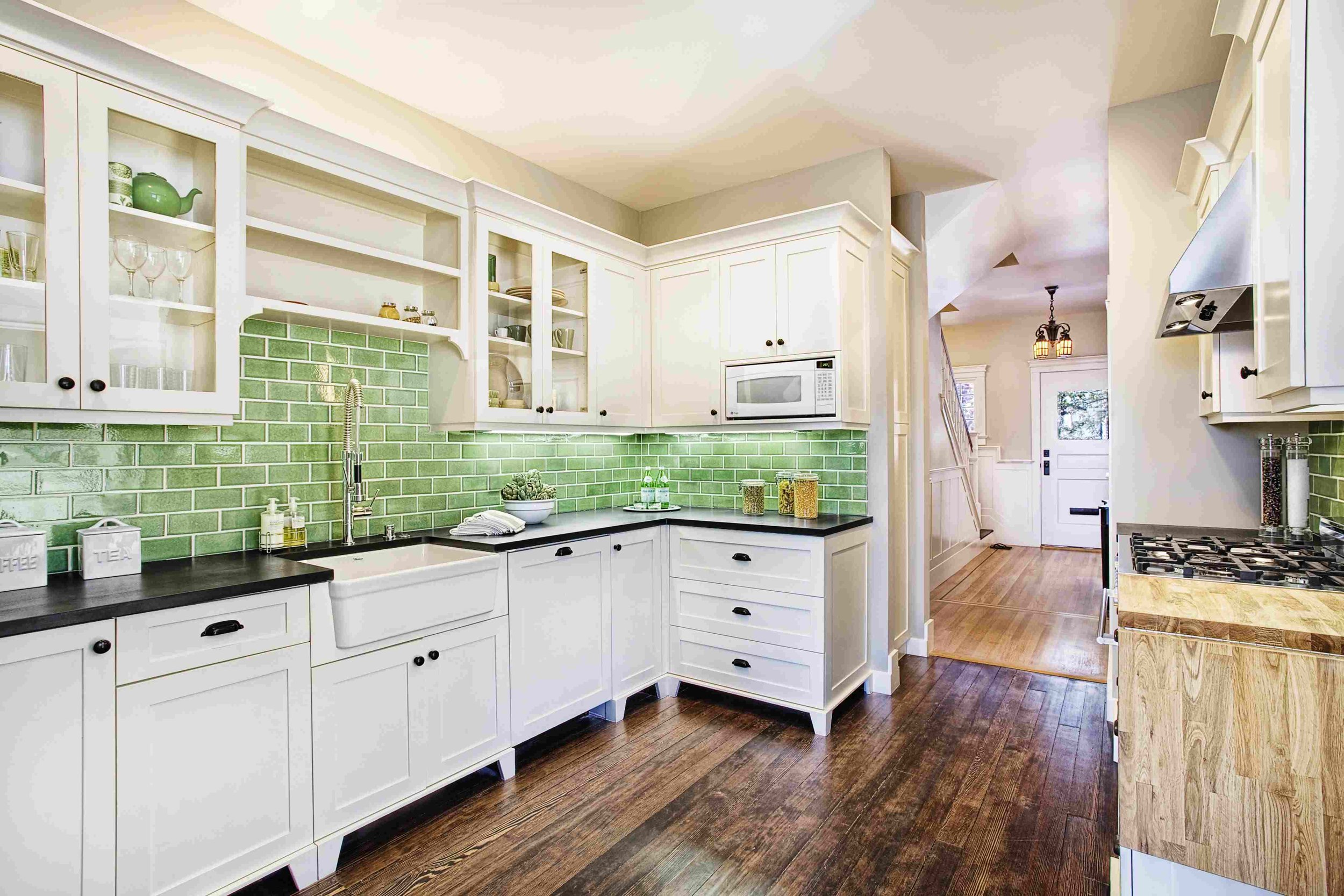 7. Colorful Kitchens - Who said kitchens had to be white or brown only? Well, 1990 - 2015 decor experts, that's who.But starting around 2015, we have seen a renaissance with the bold, beautiful and colorful kitchen.For Summer 2018 we are LOVING a little COLOR in our kitchen designs! Brightly colored elements have become a recent trend in decor, so why stop at just an accent wall?Designers are incorporating colorful light fixtures, backsplash tile, and appliances to spice up spaces into personalized and original designs.