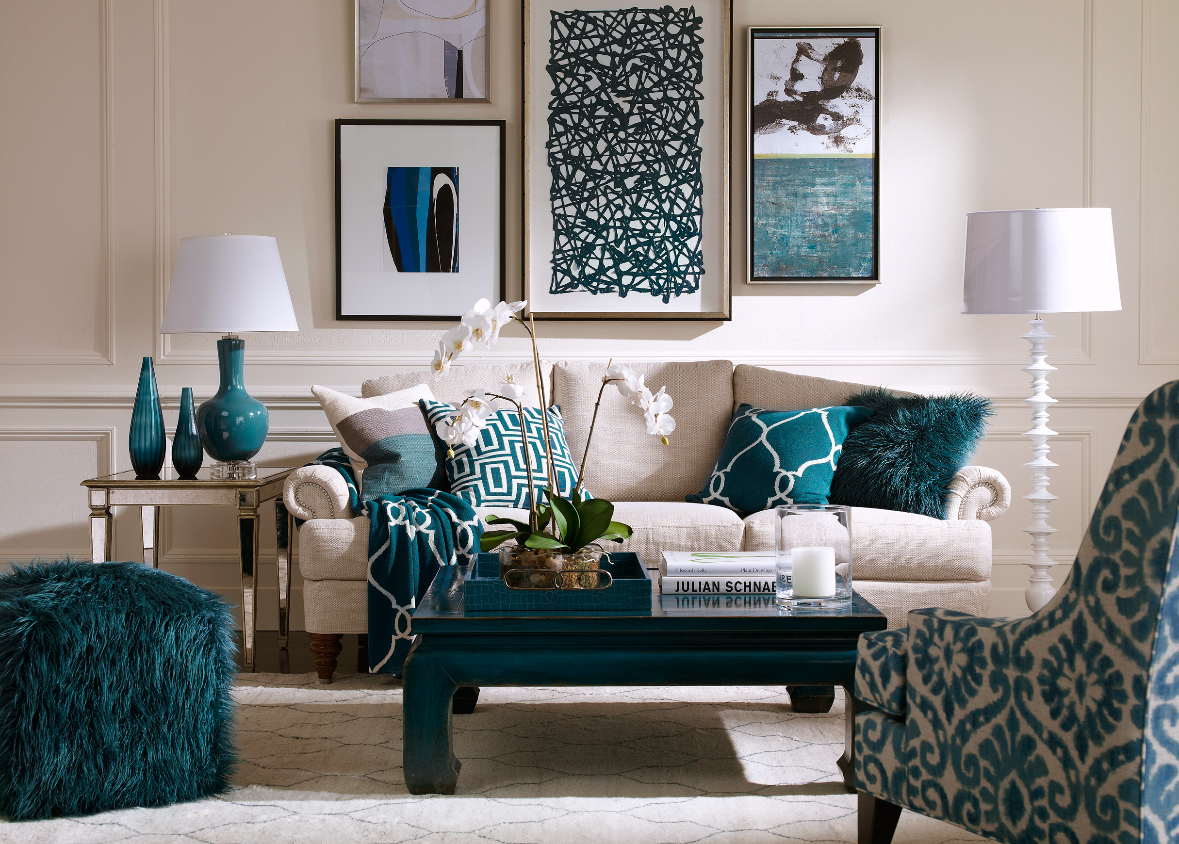 4. Accent Colors - While you may love the neutral trend, integrating colors into your palette can make any house feel like a home. Bright or rich colors can warm your living space and make your guests feel invited.Be consistent with the colors you bring into your decor. For example, if royal blue is your accent color, achieve the look by adding royal throw pillows, artwork, and curtains.