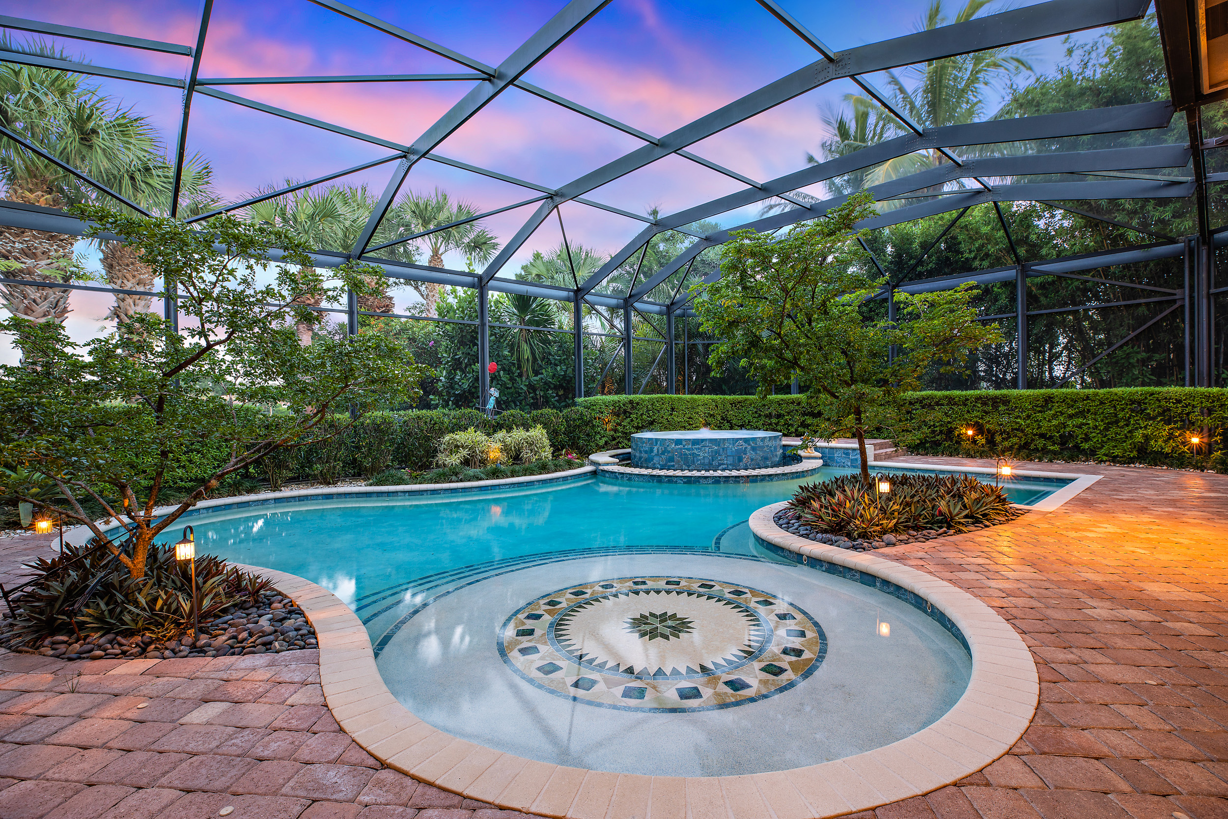 - The home's sparkling freeform pool is simply magnificent with a beautiful custom waterfall feature providing tranquil ambiance from the pool's elevated, oversized spa, which is enough for you to full stretch out and live your best life.